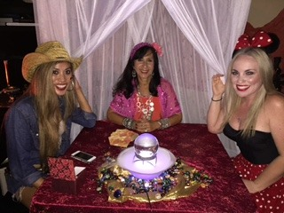 Female psychic performing accurate psychic readings for her two clients