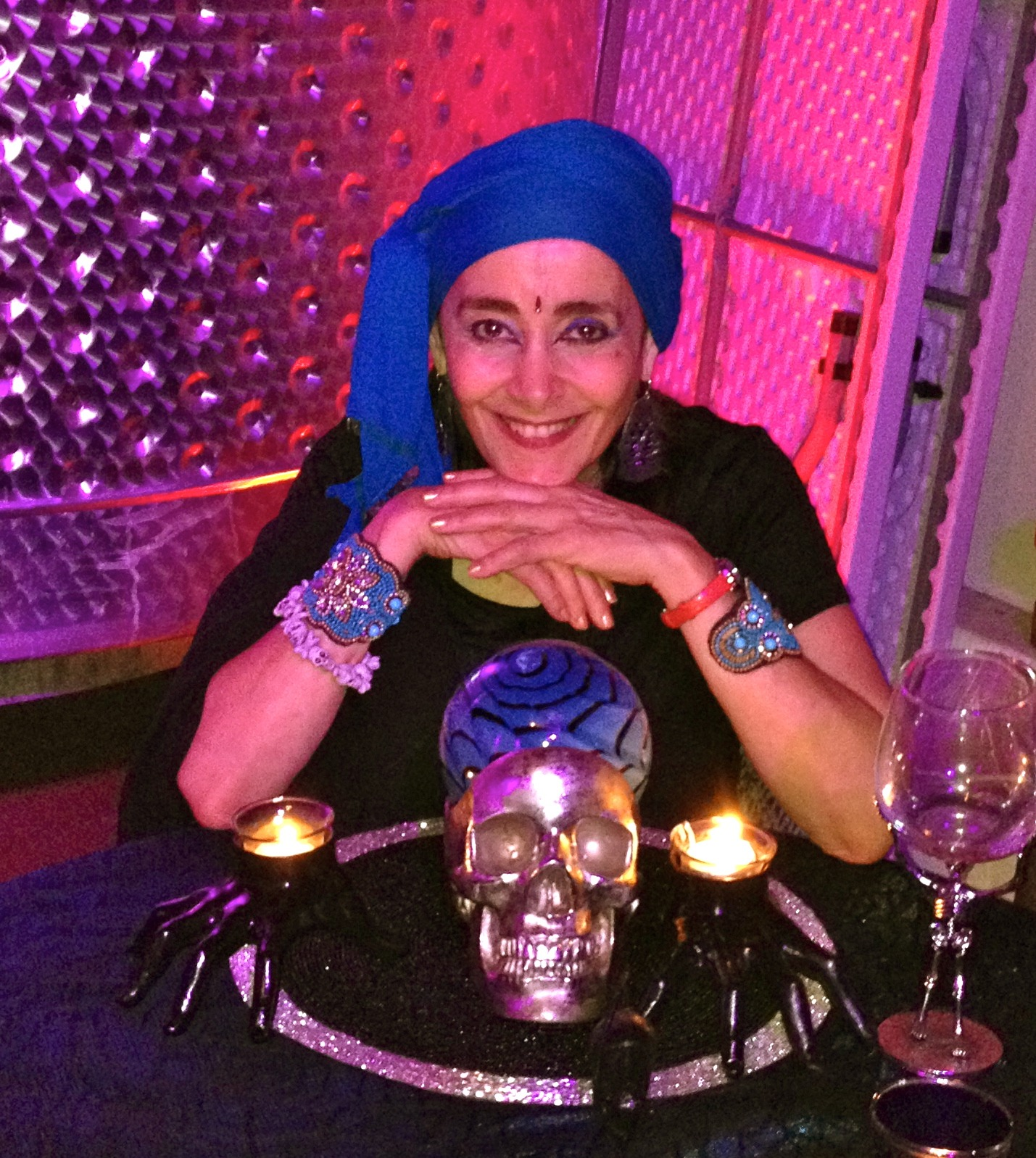 Female psychic with a blue turban posing for her fortune telling