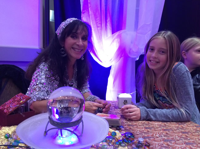 Female psychic and her female client in a crystal ball reading