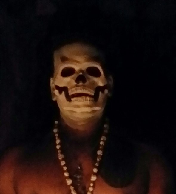 Psychic with skeleton mask performing voodoo