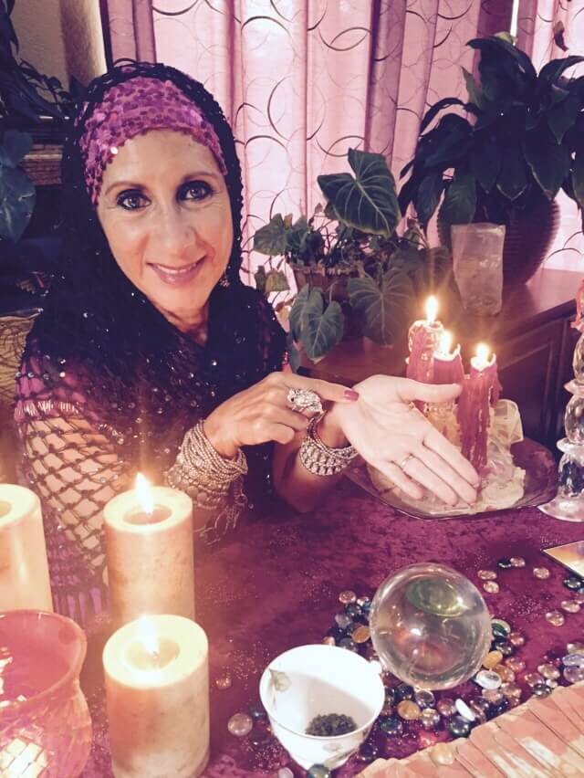 female psychic showing and pointing at her palm