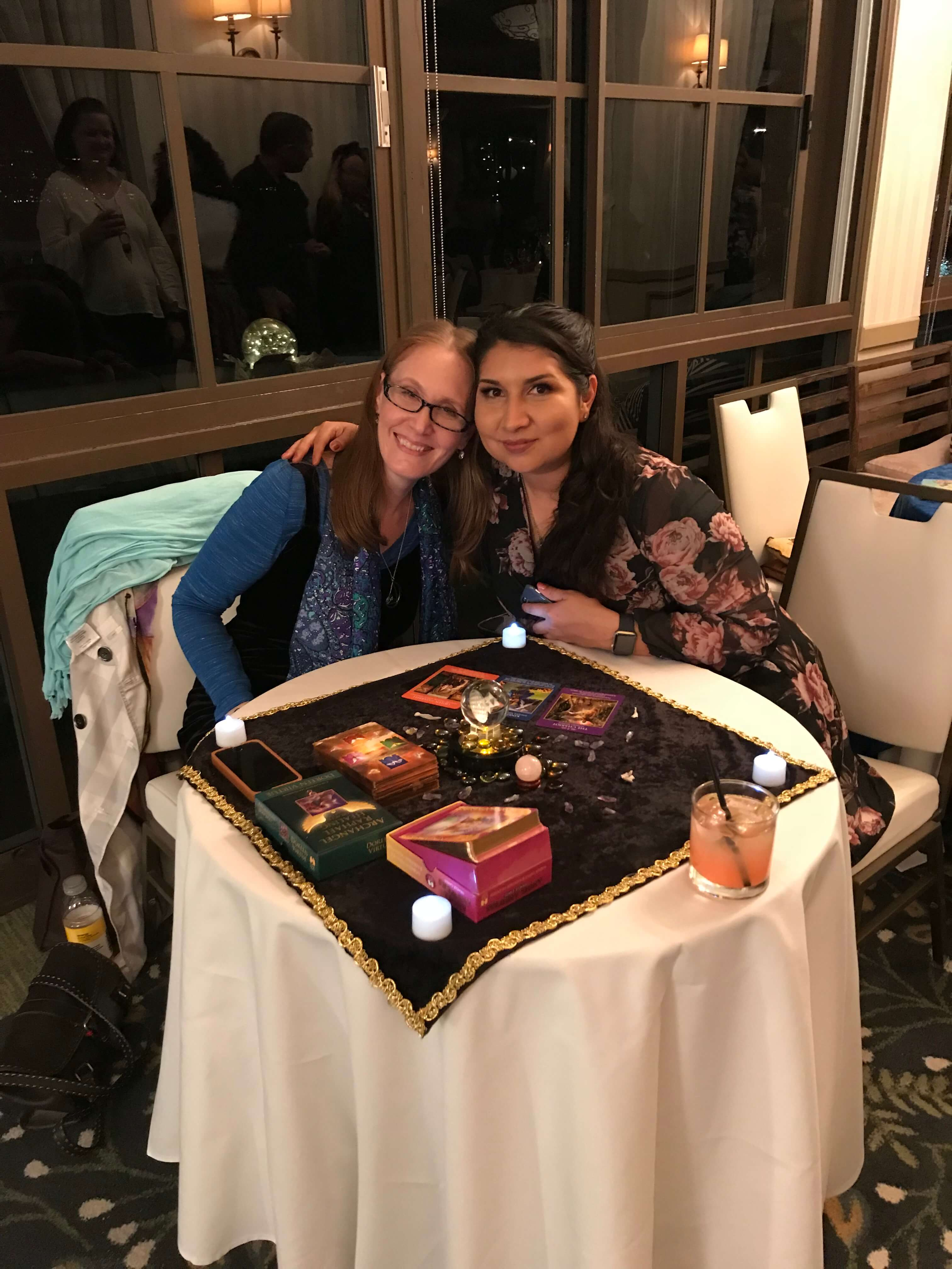 female astrologer and a female client posing for a picture