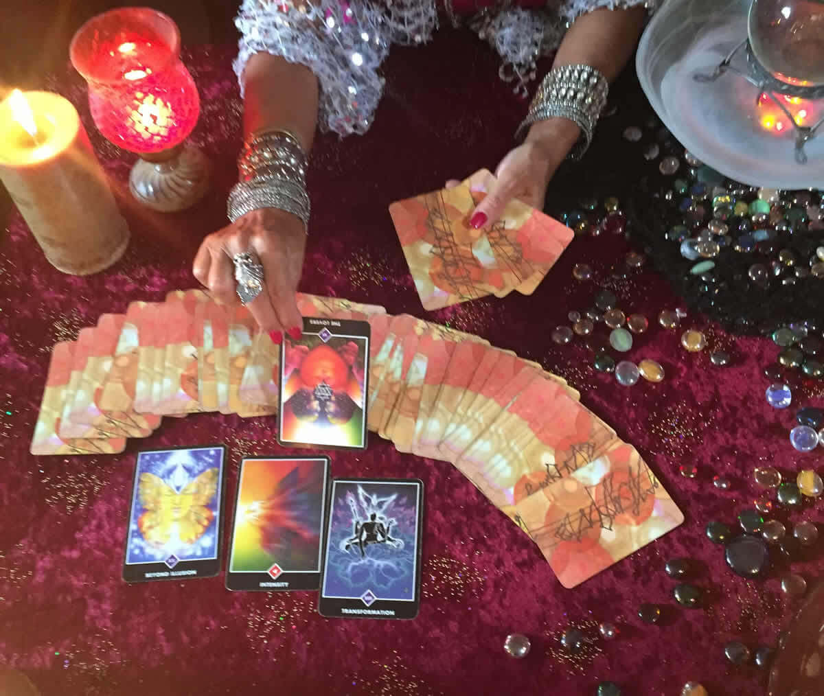 Female psychic's hands showing off her tarot card readings