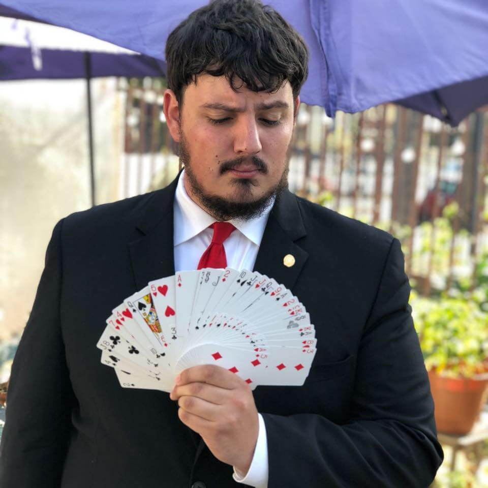 a magician showing off his card tricks