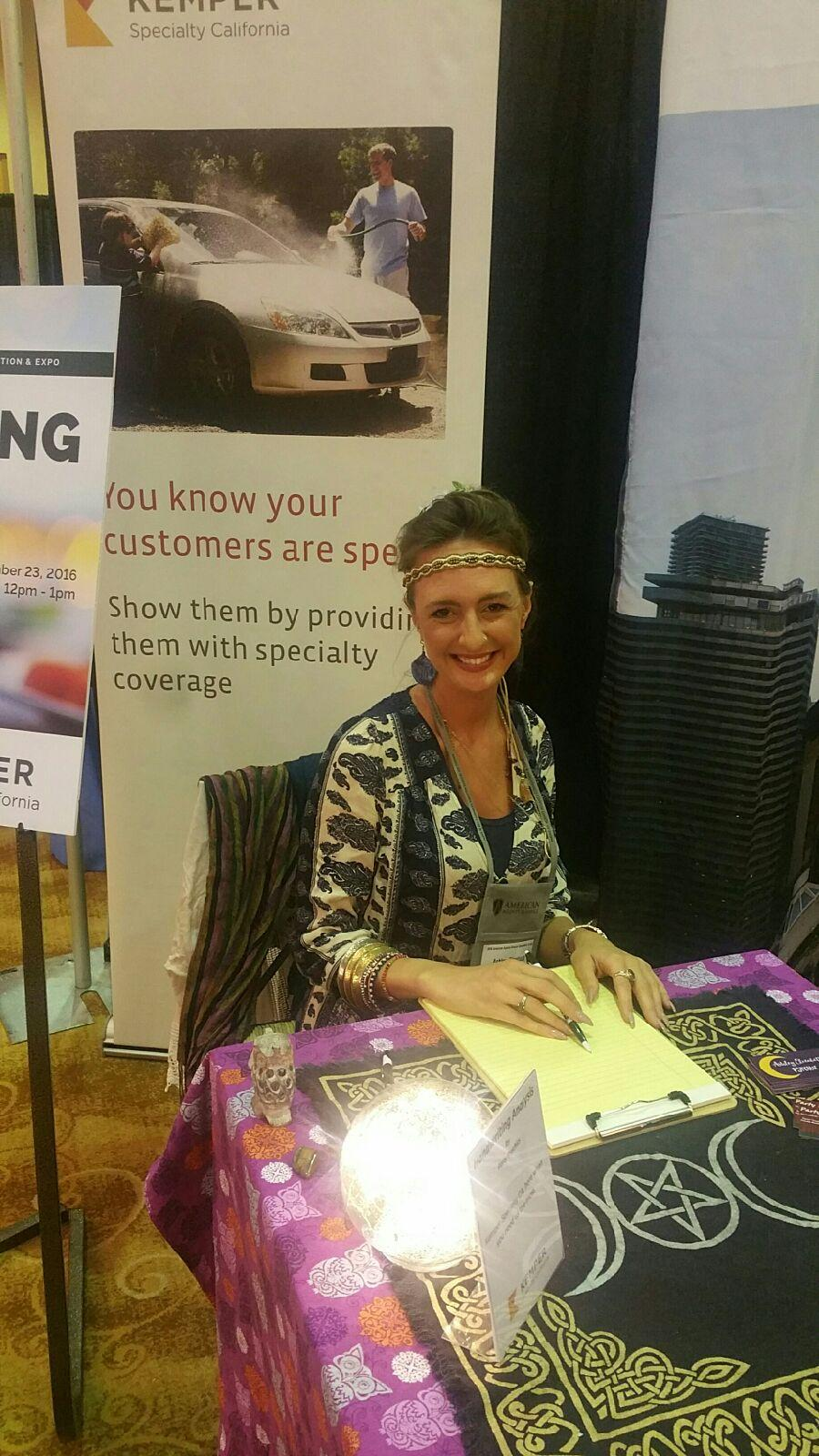 a smiling female psychic doing a handwriting analysis